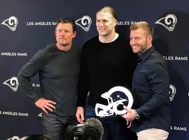 Agoura High graduate Clay Matthews, center, stands with general manager Les Snead, left, and head coach Sean McVay during a news conference announcing the Rams signing of the former Packers linebacker on Thursday in Thousand Oaks.