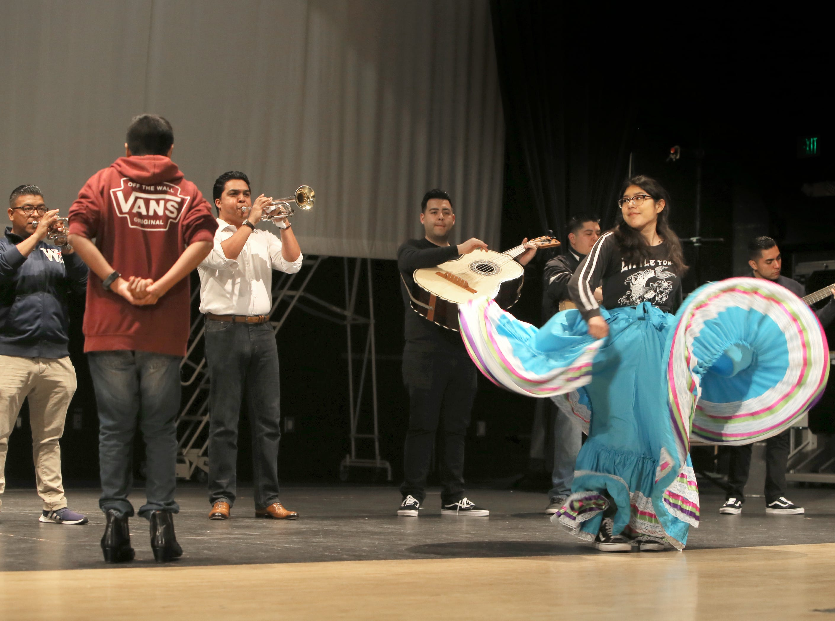 """Jahir Covarrubias and his sister Jazmin perform a traditional Mexican dance during Wednesday's rehearsal for the mariachi opera """"El Bracero."""""""