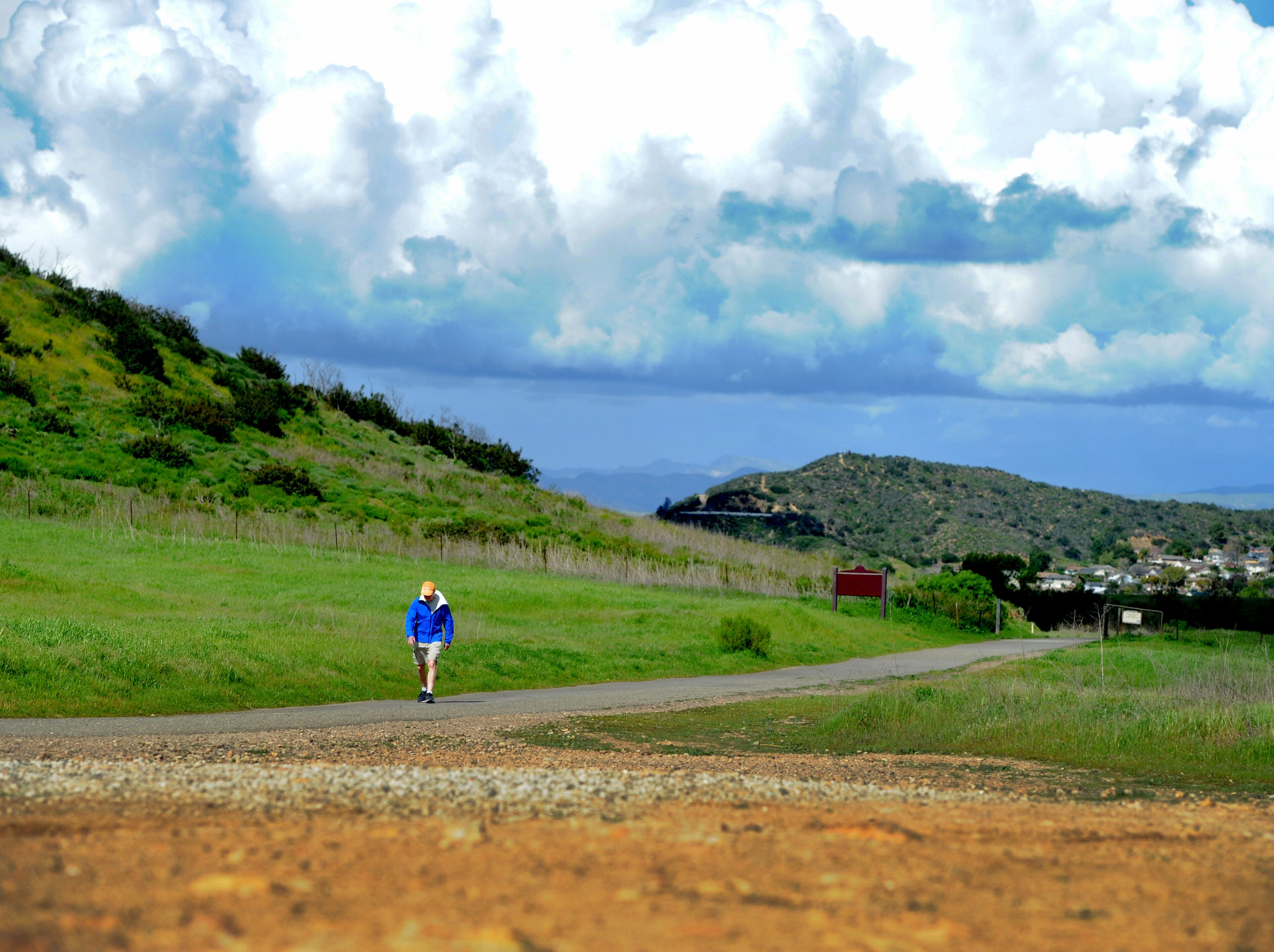 Leslie Simpson hikes across Rancho Sierra Vista to Point Mugu State Park on a cloudy Wednesday afternoon. A new report ranks Ventura County as the ninth healthiest county in California, partly because of its access to physical activity.