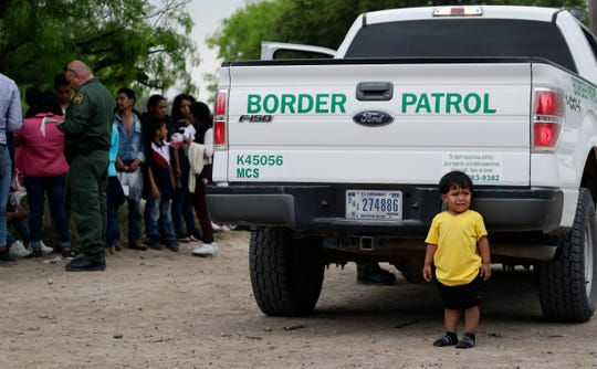 In this March 14 photo, William Josue Gonzales Garcia, who was traveling with his parents, waits with other families who crossed the nearby U.S.-Mexico border near McAllen, Texas.