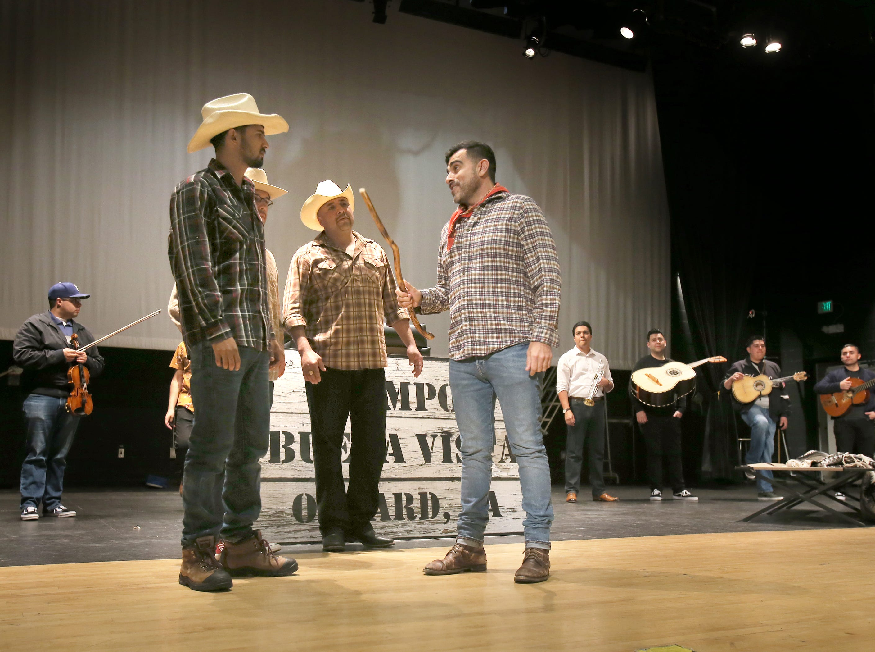 """Armando Rey, from right, Fernando Garcia, Daniel Smithson and Jonathan Lopez perform one of their scenes during Wednesday's rehearsal for the mariachi opera """"El Bracero."""" Lopez, who is from Ensenada, Mexico, plays the lead character Noe."""