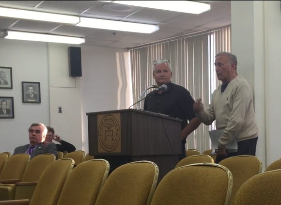 Synergy LLC principals Steve Trumbo (left, standing) and Steve Durst (right, standing) speak at the March 19 City Commission meeting. Their company secured commission blessing to ask Atlantic City Electric to consider an idea to link municipal facilities to a solar power facility for their electricity needs.