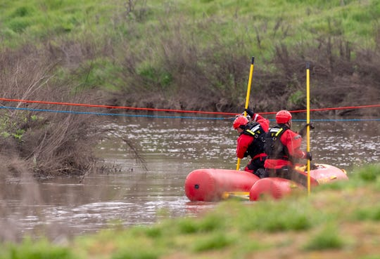 Tulare County Sheriff Department looks for man in the St. Johns River about 1/2-mile west of Ben Maddox Way on Thursday, March 21, 2019.