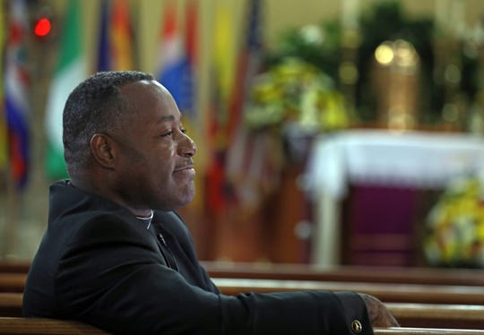 The Rev Levelt Germain of St. Joseph's Church was photographed in the sanctuary in Spring Valley March 21, 2019. The church, which has a diverse congregation from the Caribbean, Central and South America, will mark its 125th anniversary with a variety of celebrations in the coming months.
