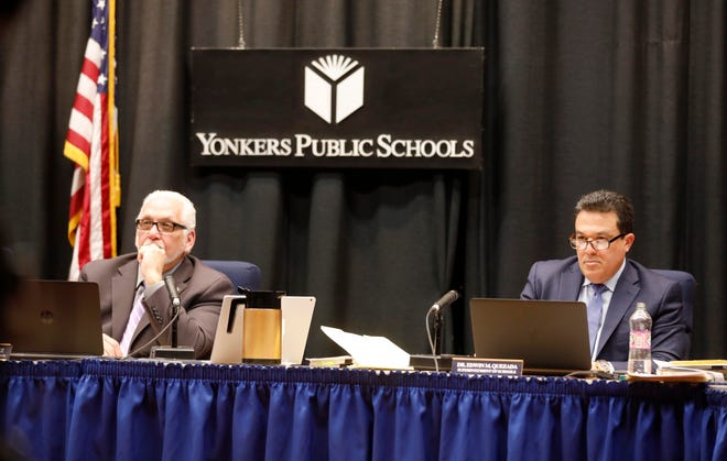 The Rev. Steve Lopez, left, President of the Yonkers Board of Education, and Edwin Quezada, Superintendent of the Yonkers Schools, listen to speakers during a public meeting on the proposed CAST charter school March 20, 2019. The majority of speakers spoke in opposition to the creation of the school. Superintendent Quezada also spoke in opposition to the creation of the school.