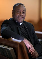 The Rev Levelt Germain of St. Joseph's Church was photographed in the sanctuary in Spring Valley March 21, 2019. The church, which has a diverse congregation from the Caribbean, Central and South America, will mark it's 125th Anniversary with a variety of celebrations in the coming months.