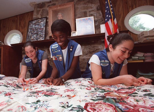 Kristen Moodhe 13, Abena Yeboah 13, and Christina Acosta 13, of Girl Scout Troop 254, Chestnut Ridge, display a sleeping bag that the group made at The Girl Scout House in New City in this file photo from June 1999