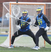 "Delaware lacrosse goalie Matt DeLuca loses some height to 6' 2"" defender Zach Strassner - but only when he crouches and spreads his 6' 6"" body across his net."
