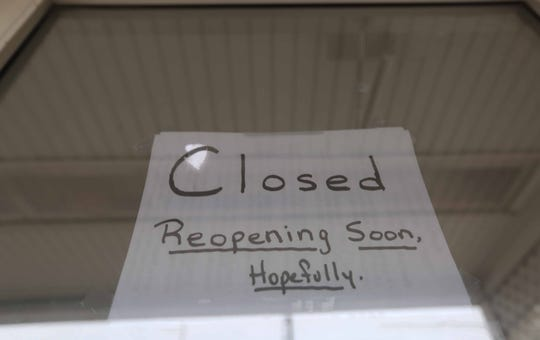 A sign taped to the front door of the Glass Kitchen Restaurant for customers remained on the door Thursday morning.