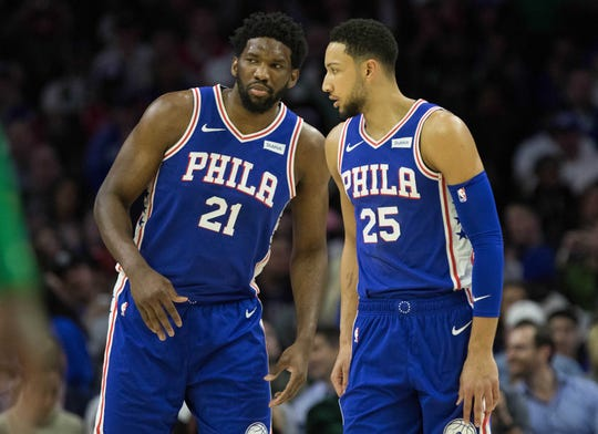 Philadelphia 76ers center Joel Embiid (21) and Philadelphia 76ers guard Ben Simmons (25) talk during the first quarter against the Boston Celtics at Wells Fargo Center on March 20.