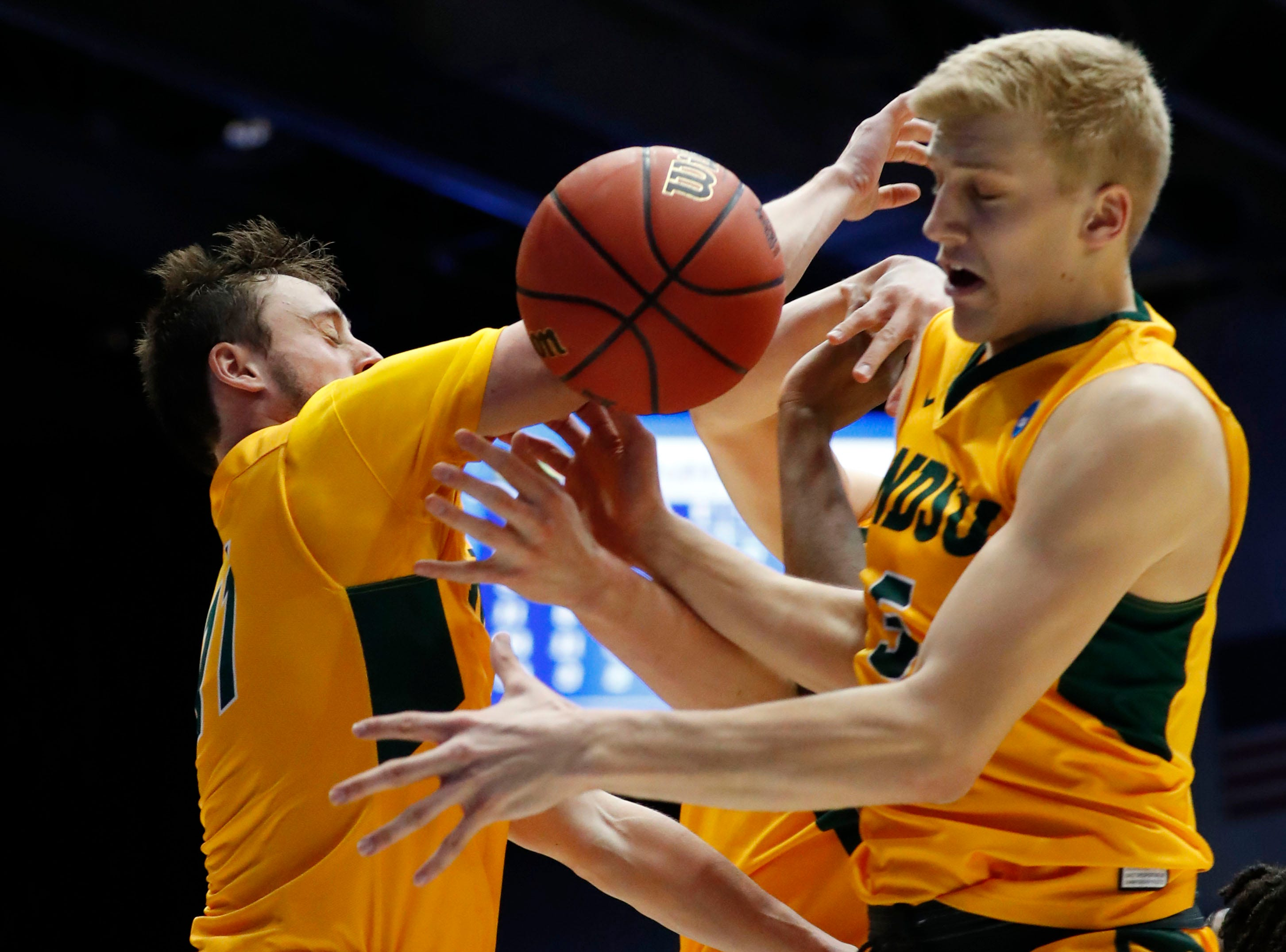 North Dakota State Bison guard Jared Samuelson (11) and guard Sam Griesel (5) attempt to get a rebound in the second half against the North Carolina Central Eagles.