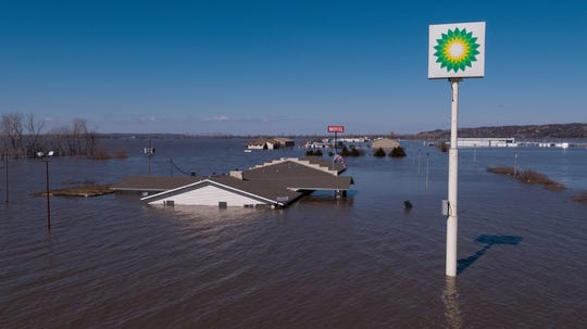 A motel sits inundated with flood water at the intersection of Highway 34 and Interstate 29 on March 20, 2019, in Mills County, Iowa.