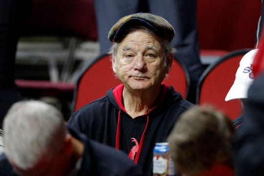 First round: Actor Bill Murray sits in the stands before the game between Minnesota and Louisville.