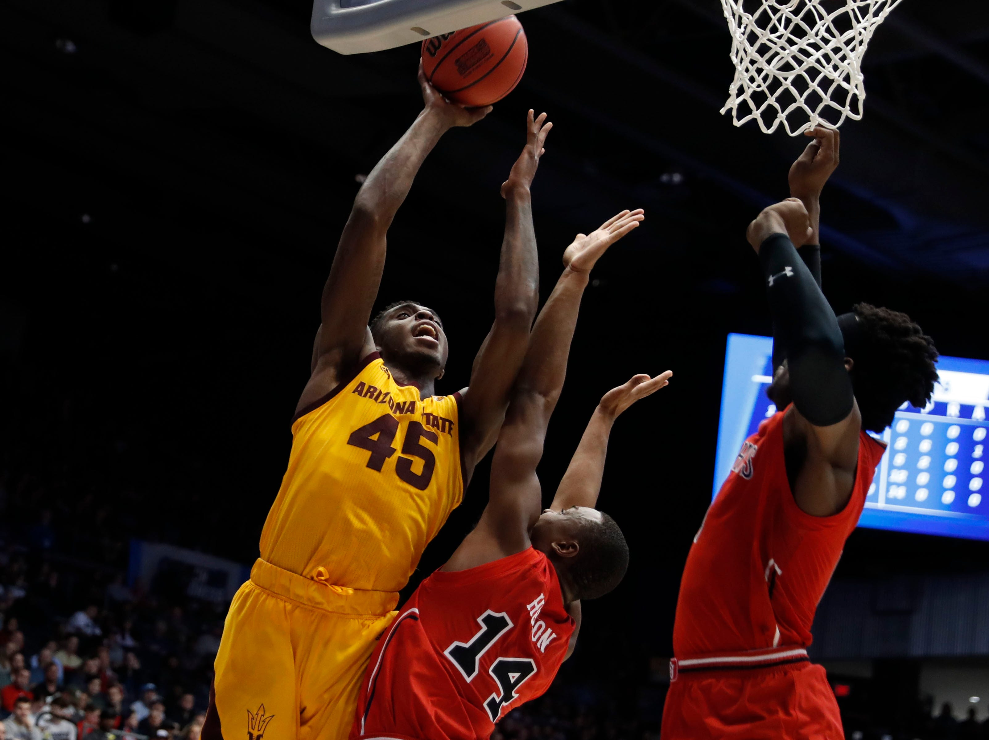 Arizona State Sun Devils forward Zylan Cheatham (45) goes to the basket defended by St. John's Red Storm guard Mustapha Heron (14).