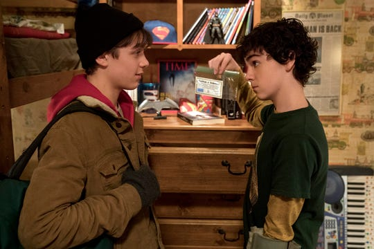 "Freddy Freeman (Jack Dylan Grazer, right) shows off his superhero memorabilia collection to new foster brother Billy (Asher Angel) in ""Shazam!"""