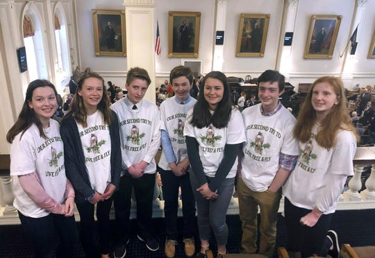 Eighth graders from Hampton Falls, N.H., stand in the gallery of the New Hampshire House in Concord in March, ahead of a vote on a bill they drafted to designate the red-tailed hawk as the state's official raptor.