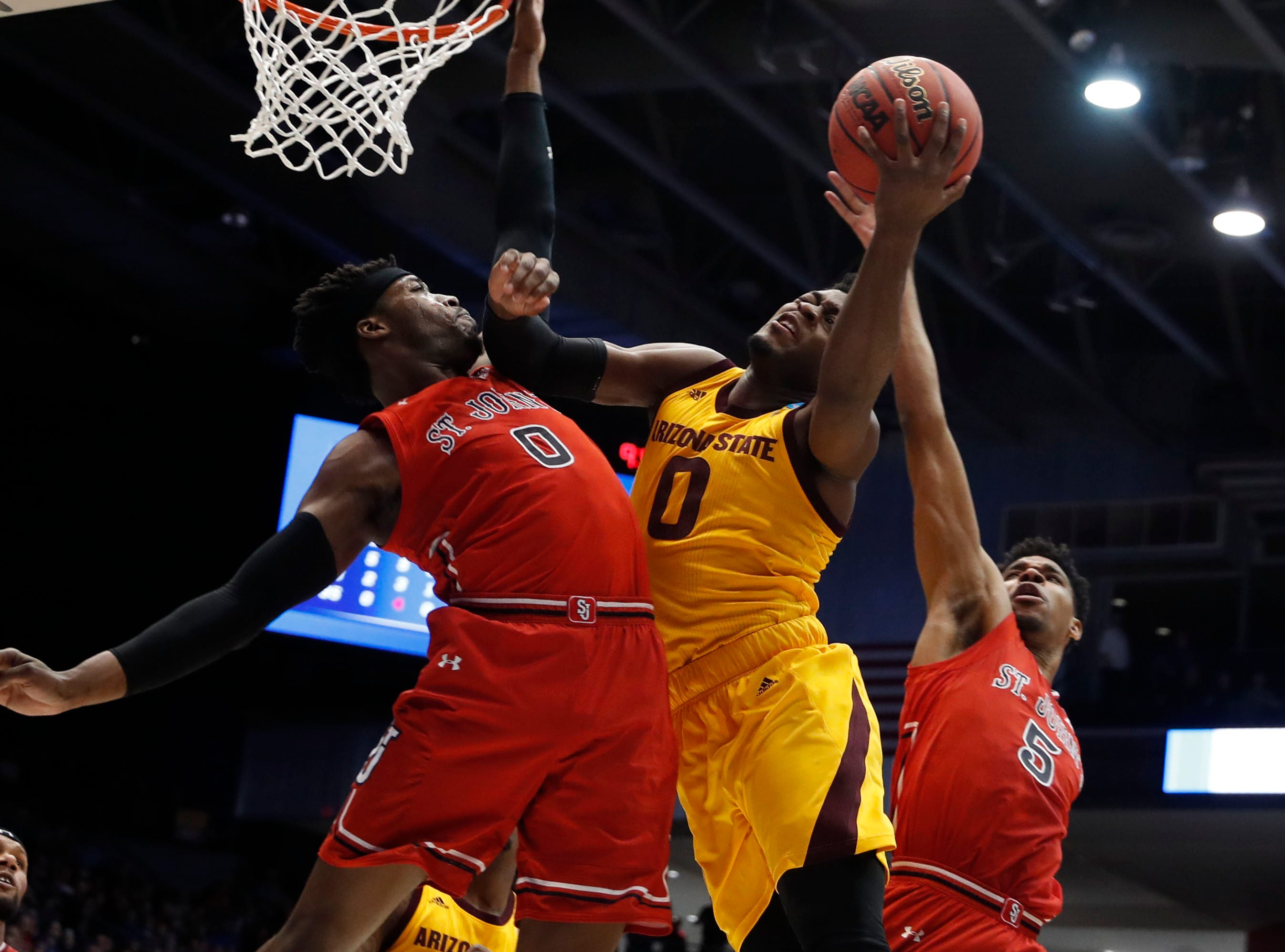 Arizona State Sun Devils guard Luguentz Dort (0) goes to the basket while defended by St. John's Red Storm forward Sedee Keita (0).