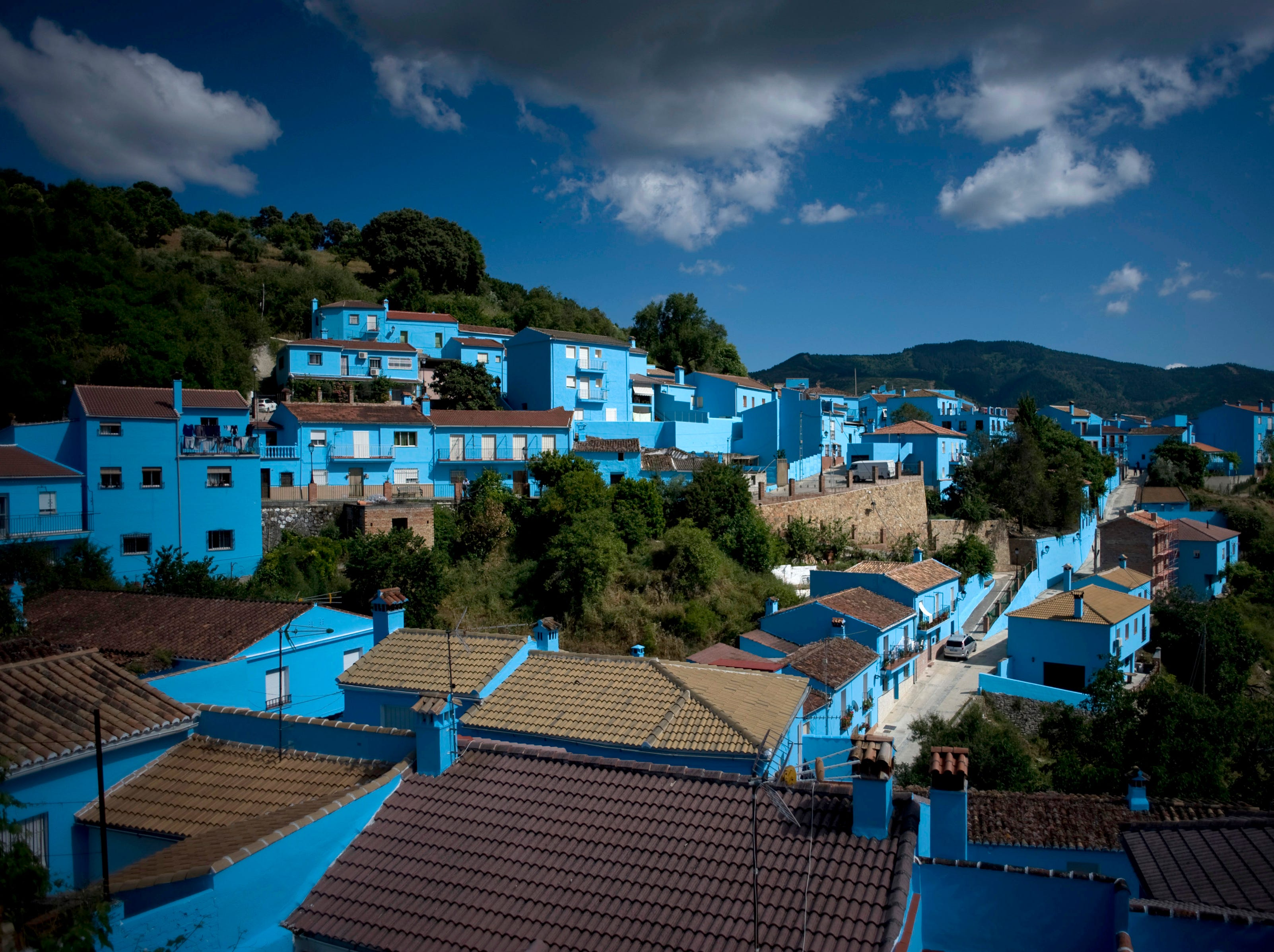 General view of the village of Juzcar taken on June 10, 2011 in Juzcar near Malaga, southern Spain. The facades of the houses of Juzcar are being painted blue after Sony chose the village to present the world premiere of the movie The Smurfs 3D. AFP PHOTO / JORGE GUERRERO (Photo credit should read Jorge Guerrero/AFP/Getty Images) ORIG FILE ID: SPAIN-CINEMA-SMURFS