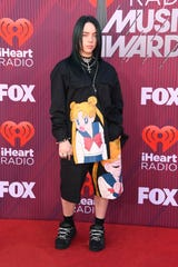 Billie Eilish walks the red carpet in a Sailor Moon-inspired outfit at the iHeartRadio Music Awards in Los Angeles this month.