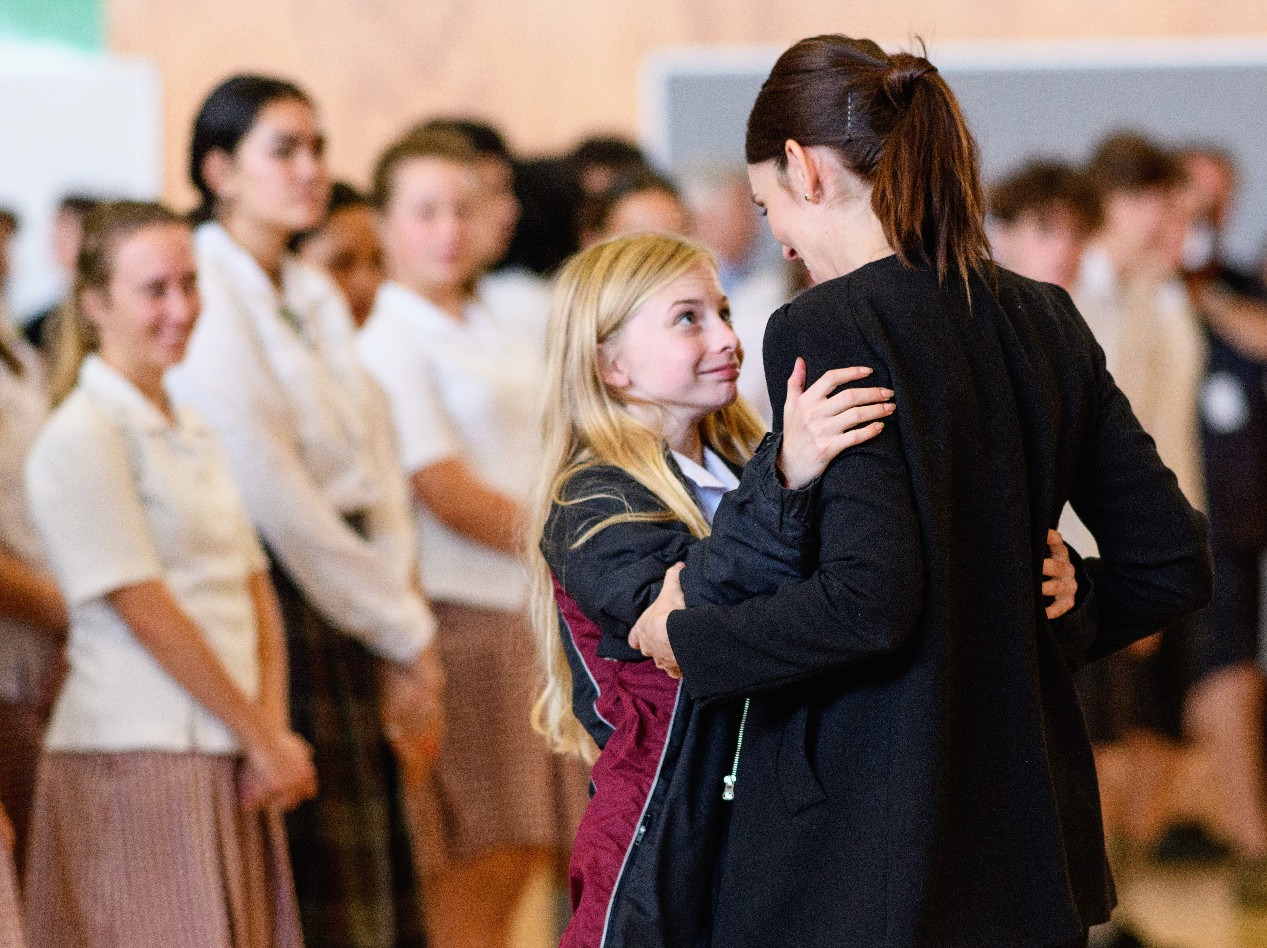 New Zealand Prime Minister Jacinda Ardern receives a hug from a student during her visit to Cashmere High School which lost two students during a mass shooting on March 20, 2019 in Christchurch, New Zealand.