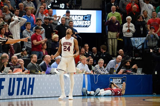 Auburn forward Anfernee McLemore reacts after New Mexico State guard Trevelin Queen misses a go-ahead 3-point attempt in the first round of the NCAA Tournament on March 21, 2019.