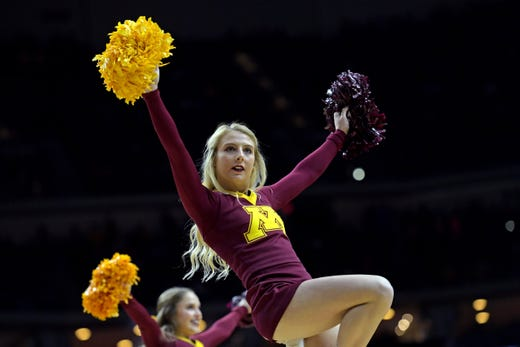 First round: Minnesota Golden Gophers cheerleaders on the court before the game against the Louisville Cardinals.
