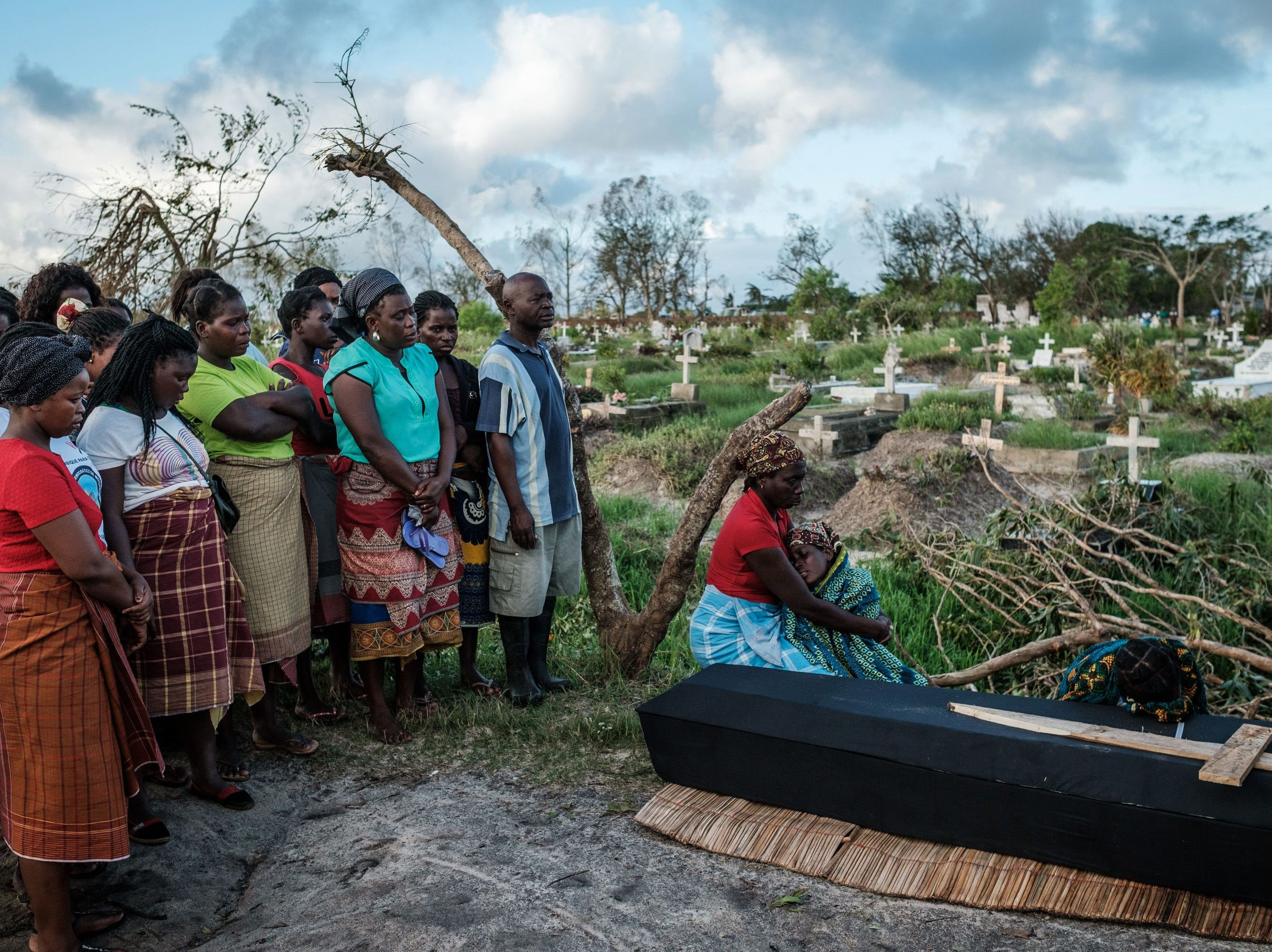 Rebecca Albino (R), a mother of three children, mourns beside the coffin of her husband, Tomas Joaquim Chimukme during his funeral. Five days after tropical cyclone Idai cut a swathe through Mozambique, Zimbabwe and Malawi, the confirmed death toll stood at more than 300 and hundreds of thousands of lives were at risk, officials said.