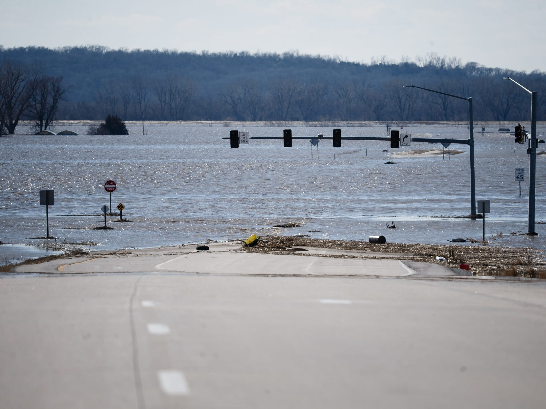 Highway 34 disappears into flood waters just west of I-29 on March 20, 2019, in Mills County, Iowa.