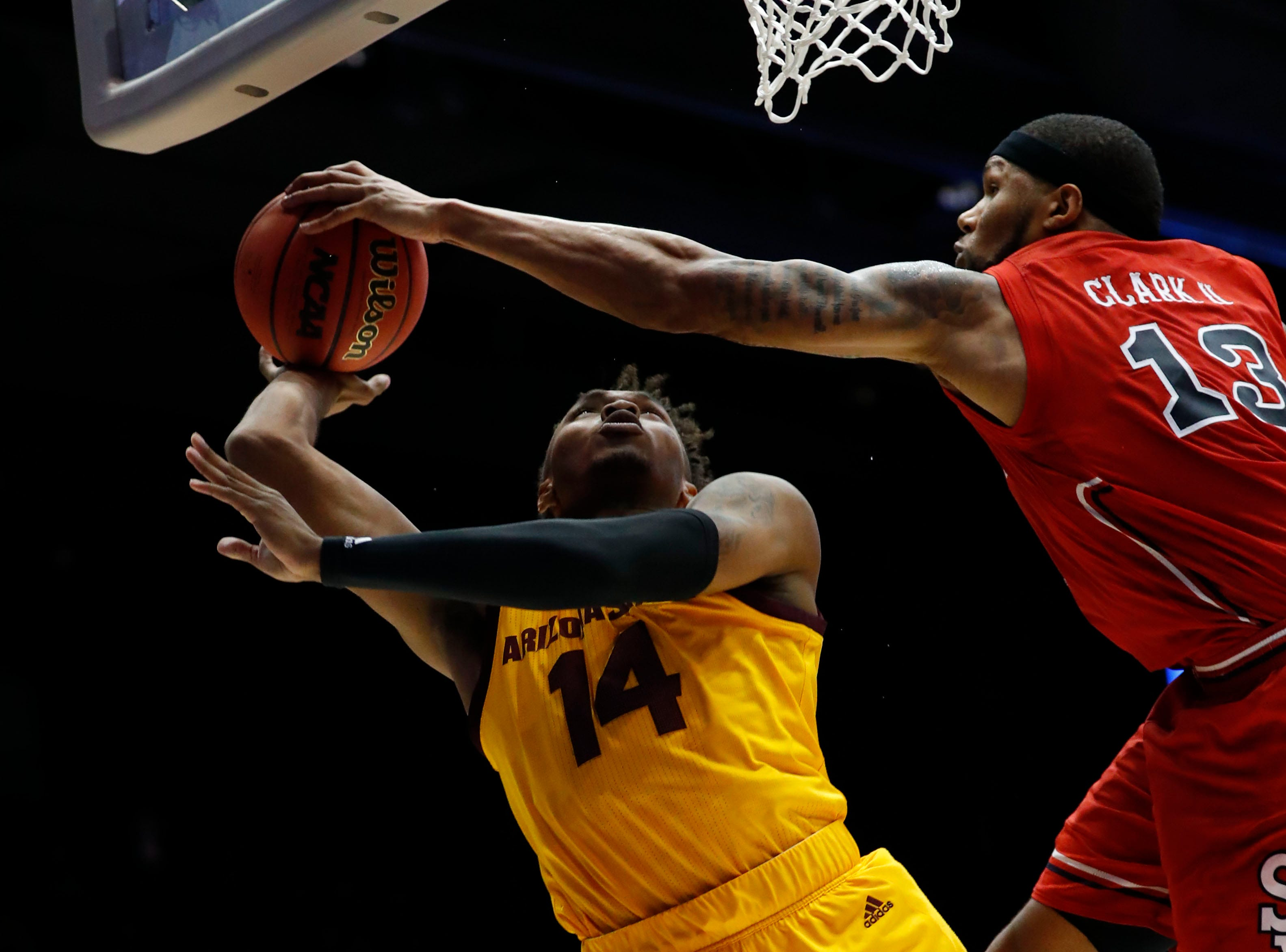 St. John's Red Storm forward Marvin Clark II (13) blocks a shot from Arizona State Sun Devils forward Kimani Lawrence (14) in the second half.