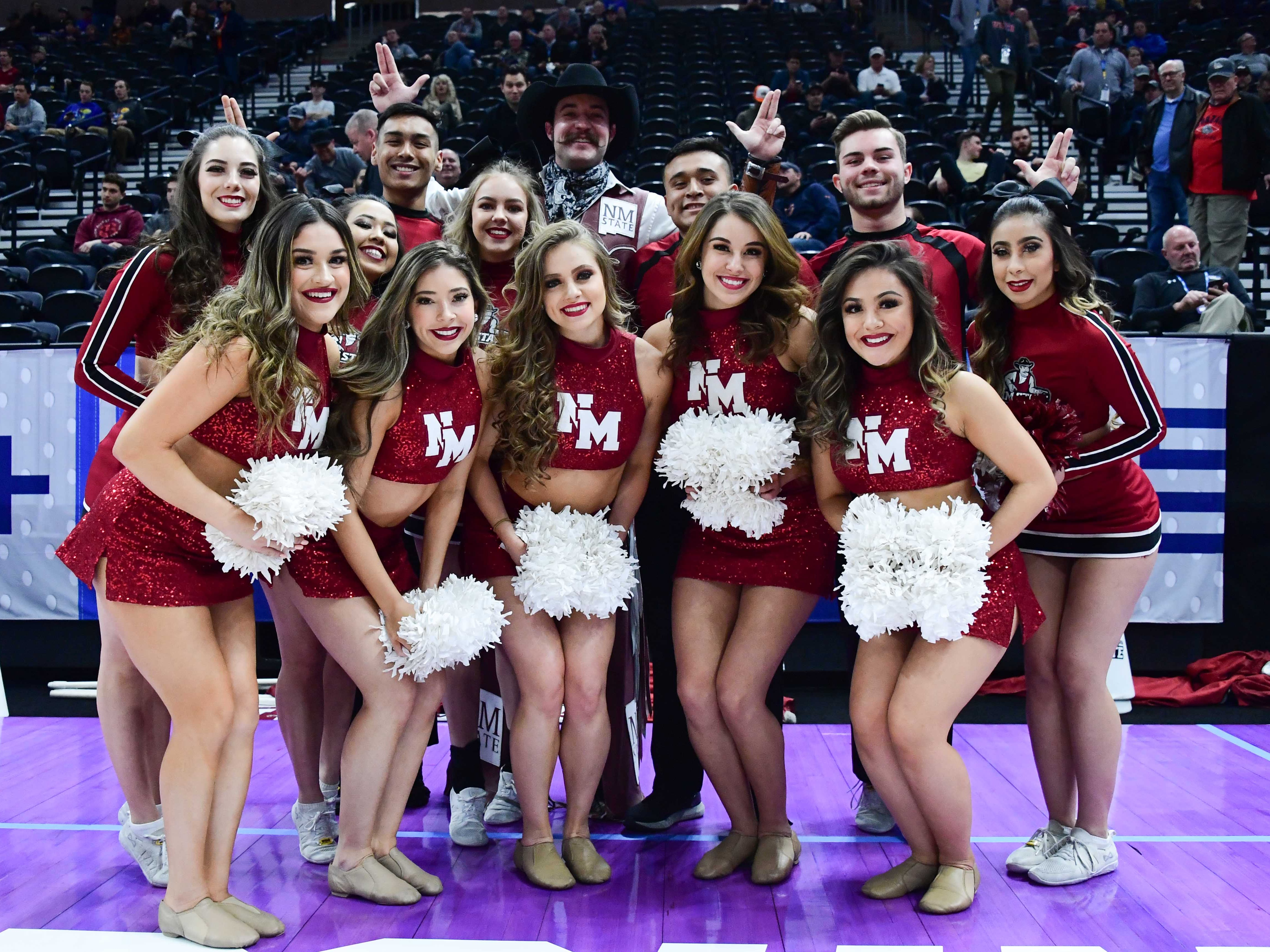 First round: The New Mexico State Aggies cheer team poses before the game against the Auburn Tigers.