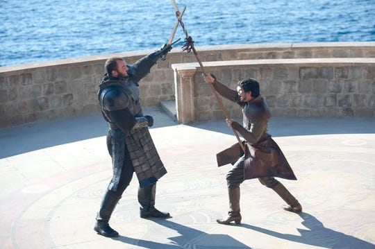 """Hafþór Júlíus Björnsson as The Mountain and Pedro Pascal as Oberyn Martell in """"The Mountain and the Viper"""" episode of """"Game of Thrones."""" (Photo: Macall B. Polay/HBO)"""