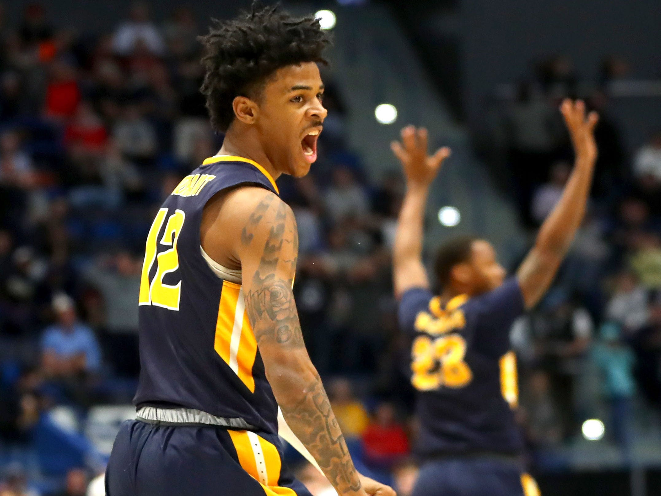 First round: Ja Morant celebrates during Murray State's upset win over Marquette -- a game in which he recorded a triple-double.