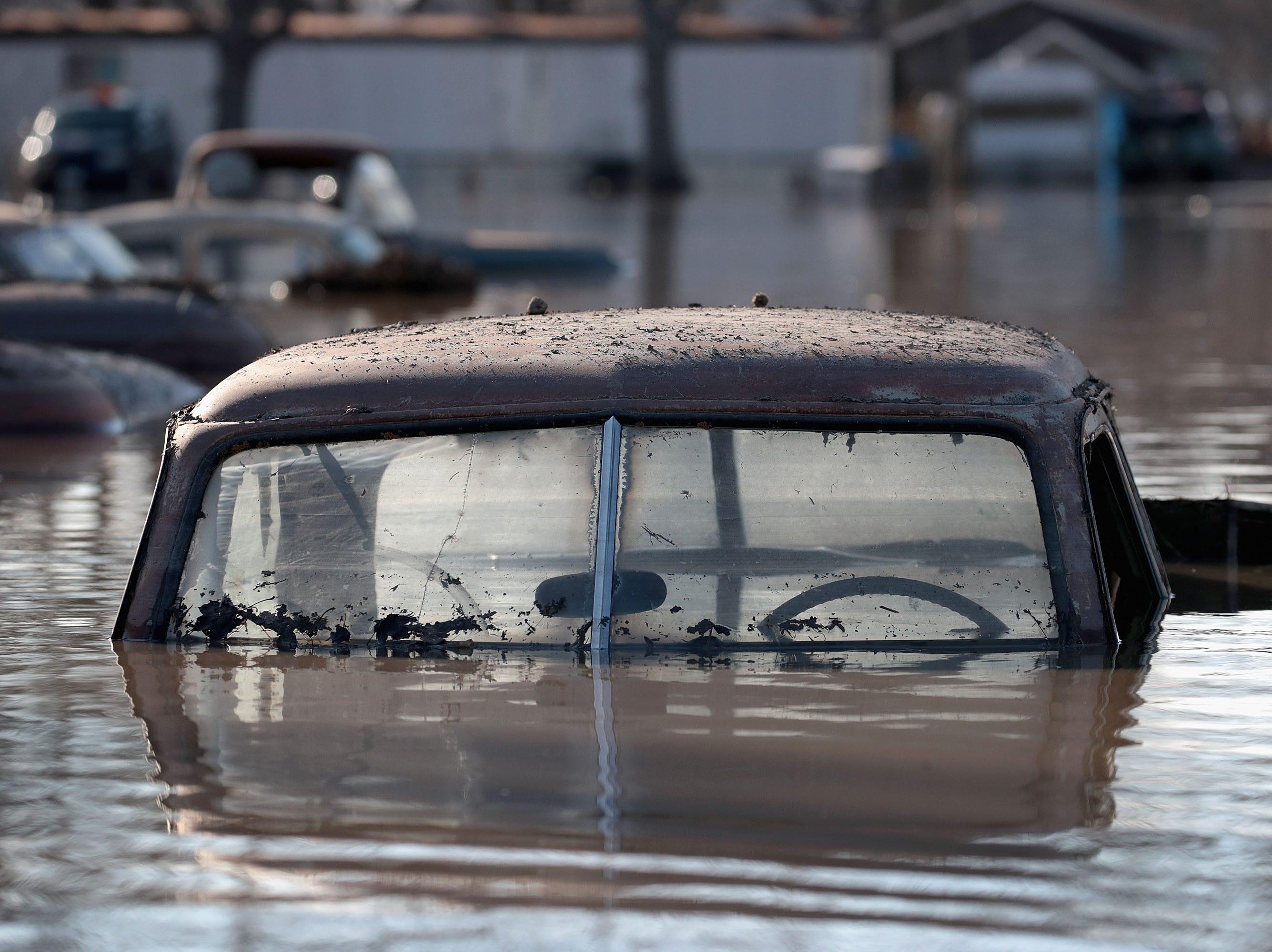 A vintage car sits in flood water on March 20, 2019 in Hamburg, Iowa.