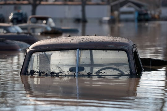 A vintage car sits in flood water on March 20, 2019 in Hamburg, Iowa.