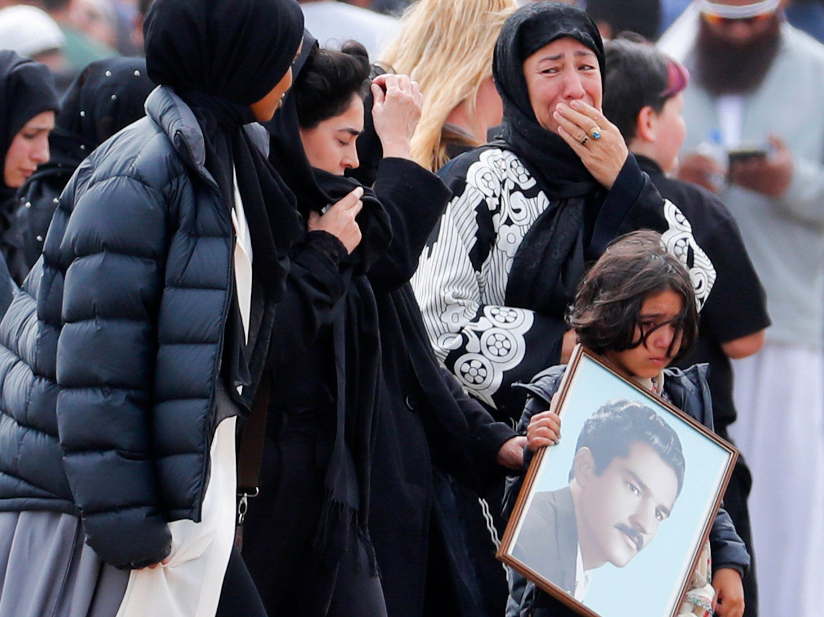 Mourners arrive for a burial service of a victim from the March 15 mosque shootings at the Memorial Park Cemetery in Christchurch, New Zealand on March 21, 2019.