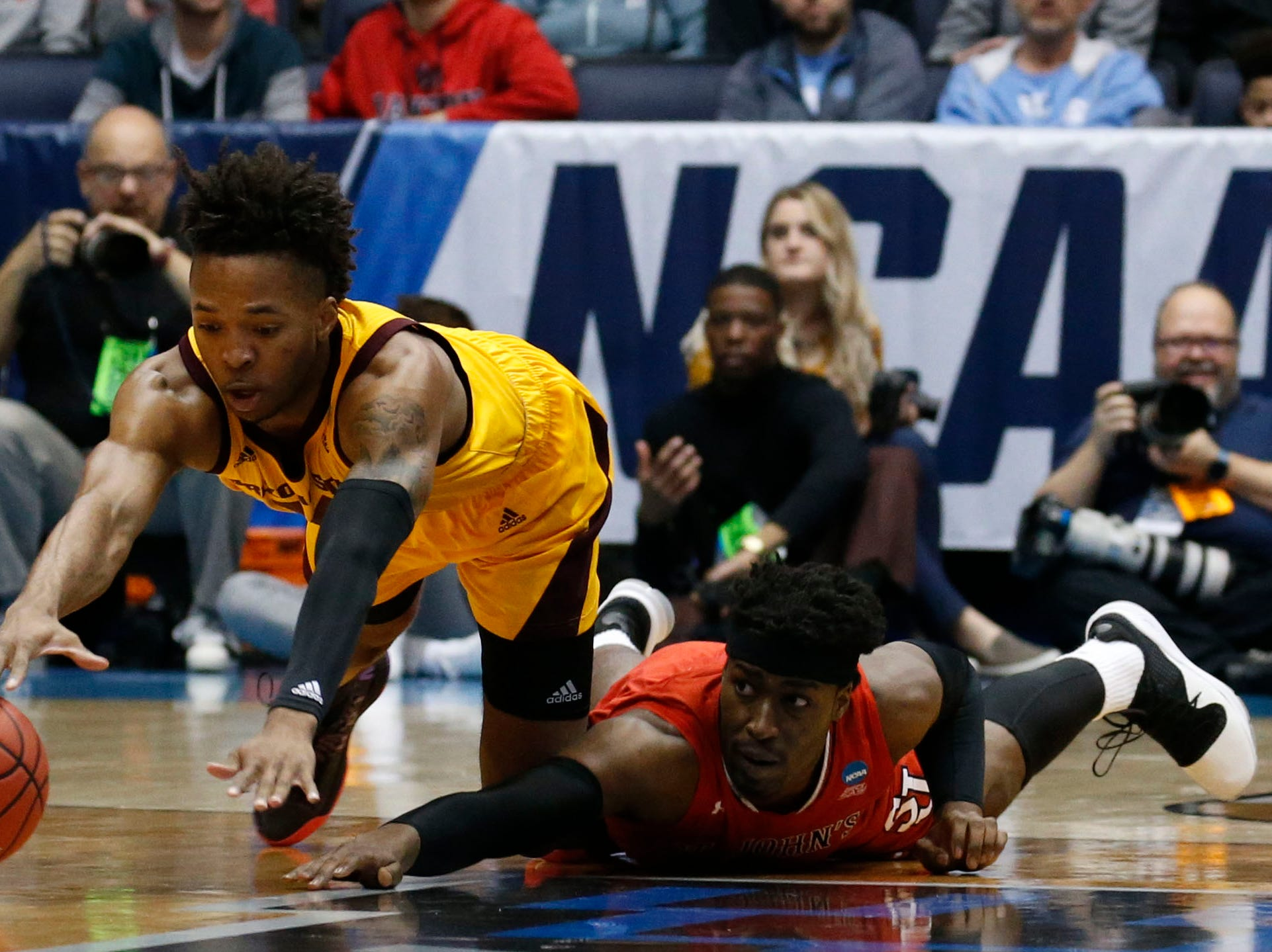 Arizona State Sun Devils forward Kimani Lawrence (14) and St. John's Red Storm forward Sedee Keita (0) dive for the ball in the first half.