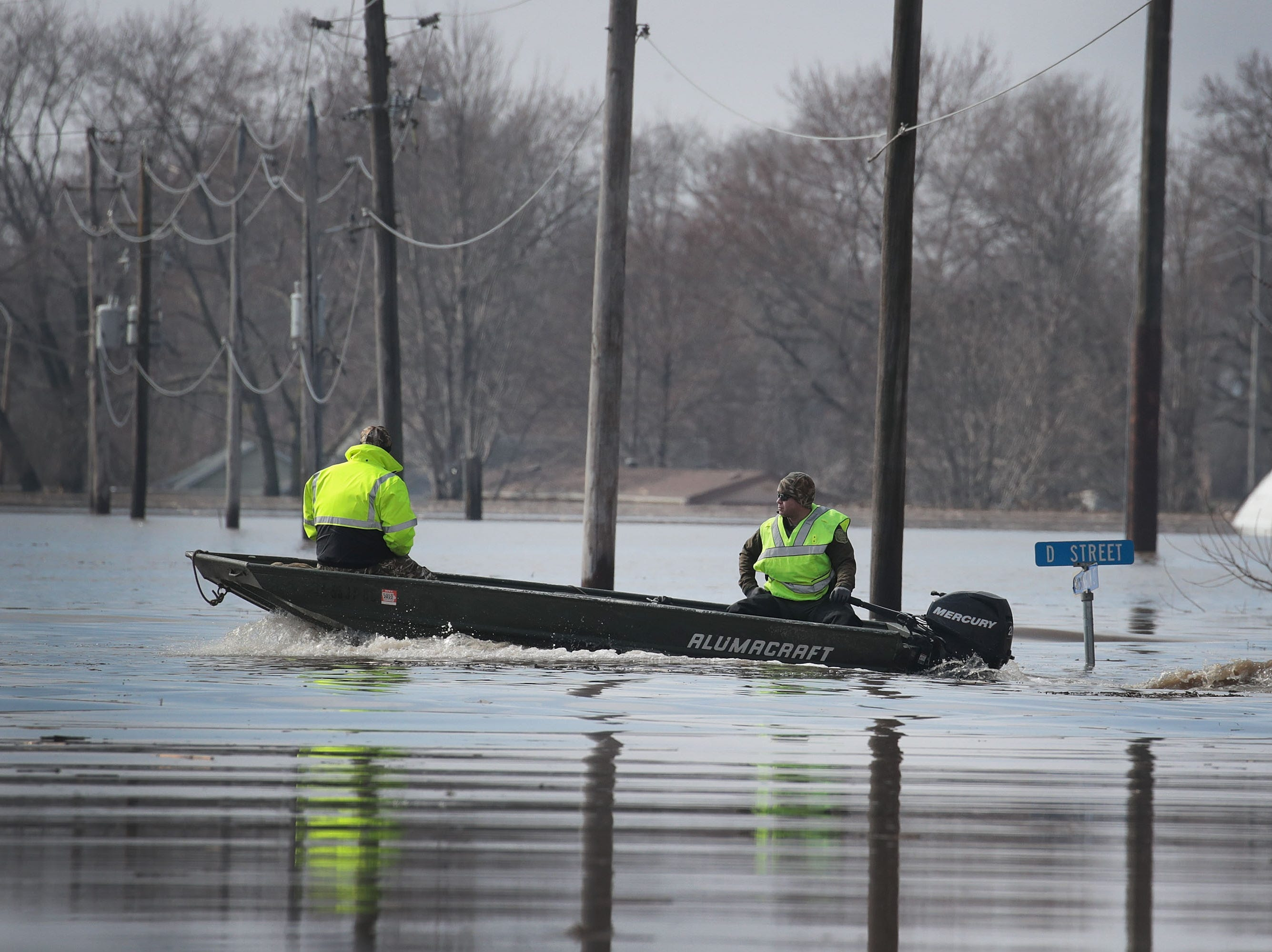 Boaters travel down a flooded street on March 20, 2019, in Hamburg, Iowa. Although flood water in the town has started to recede many homes and businesses remain surrounded by water.
