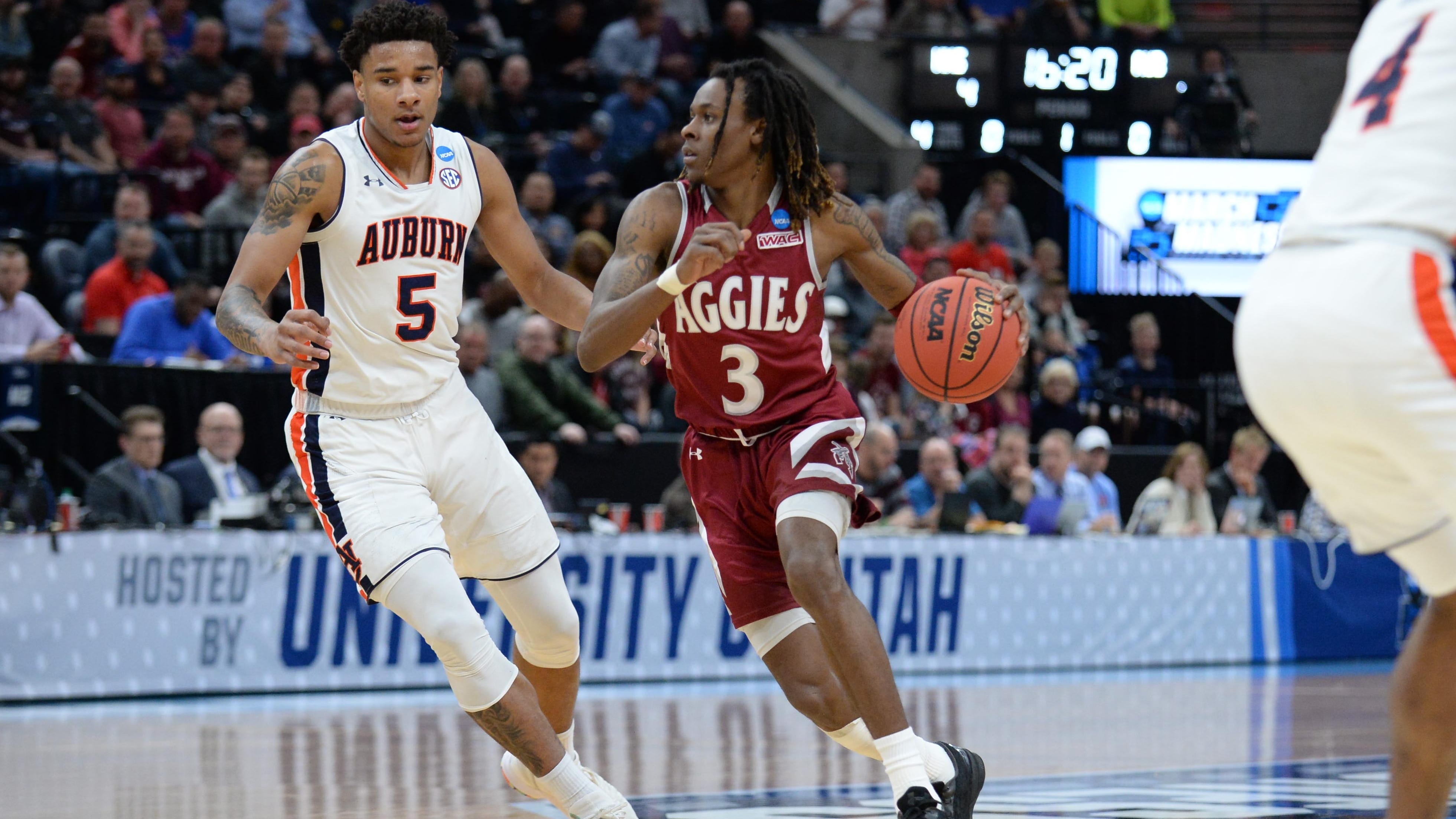 New Mexico State guard Terrell Brown drives around Auburn forward Chuma Okeke the first round of the 2019 NCAA tournament.