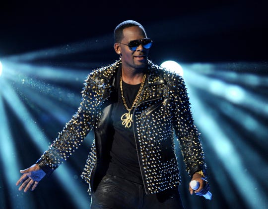 R. Kelly, seen here performs at the 2013 BET Awards in Los Angeles, is asking a Chicago judge to let him travel overseas for concerts in Dubai, saying he's been unable to get work anywhere in the U.S. since his arrest on charges he sexually abused three minor girls and an adult woman.