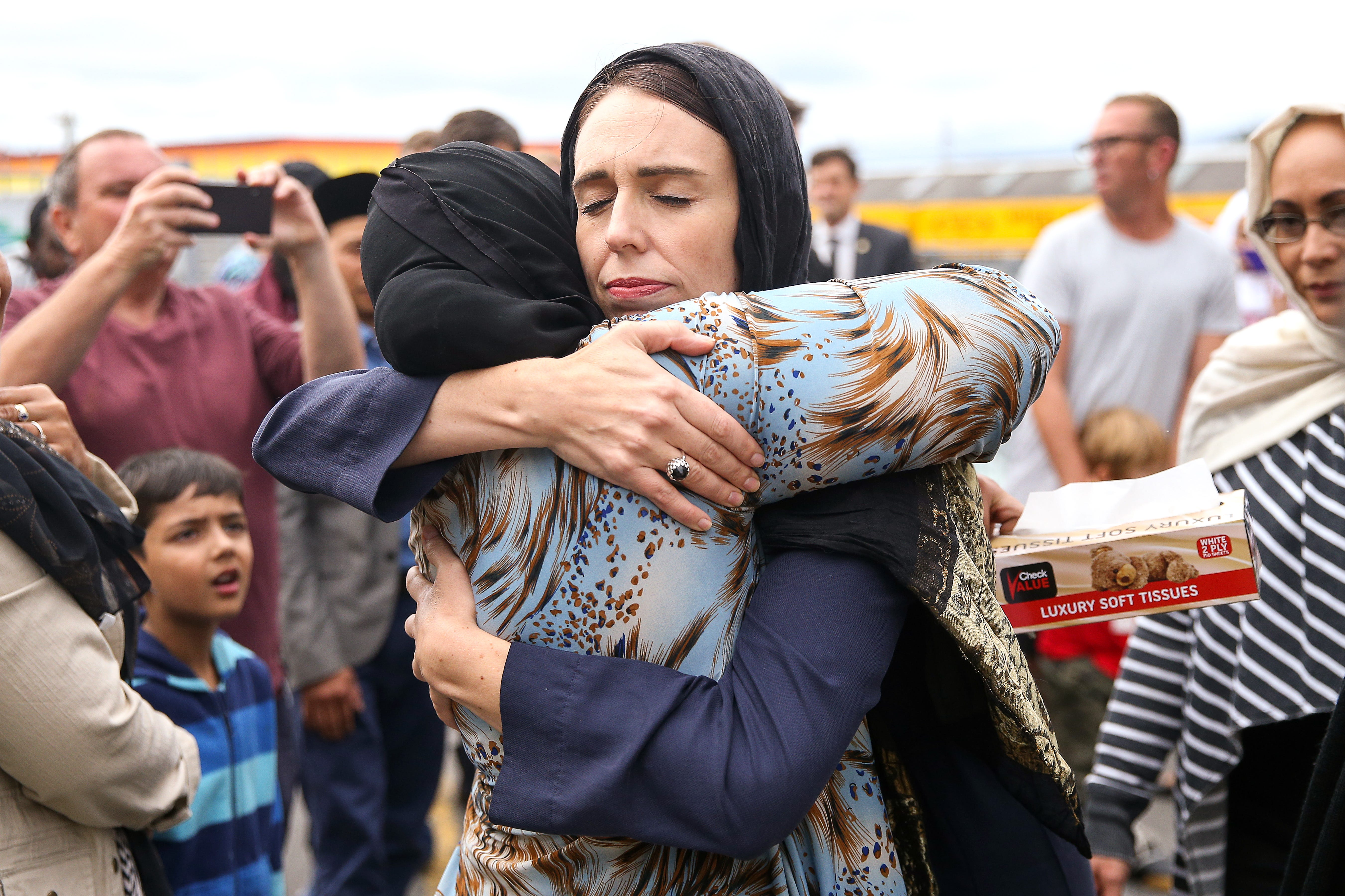 Prime Minister Jacinda Ardern hugs a mosque-goer at the Kilbirnie Mosque on March 17, 2019, in Wellington, New Zealand.