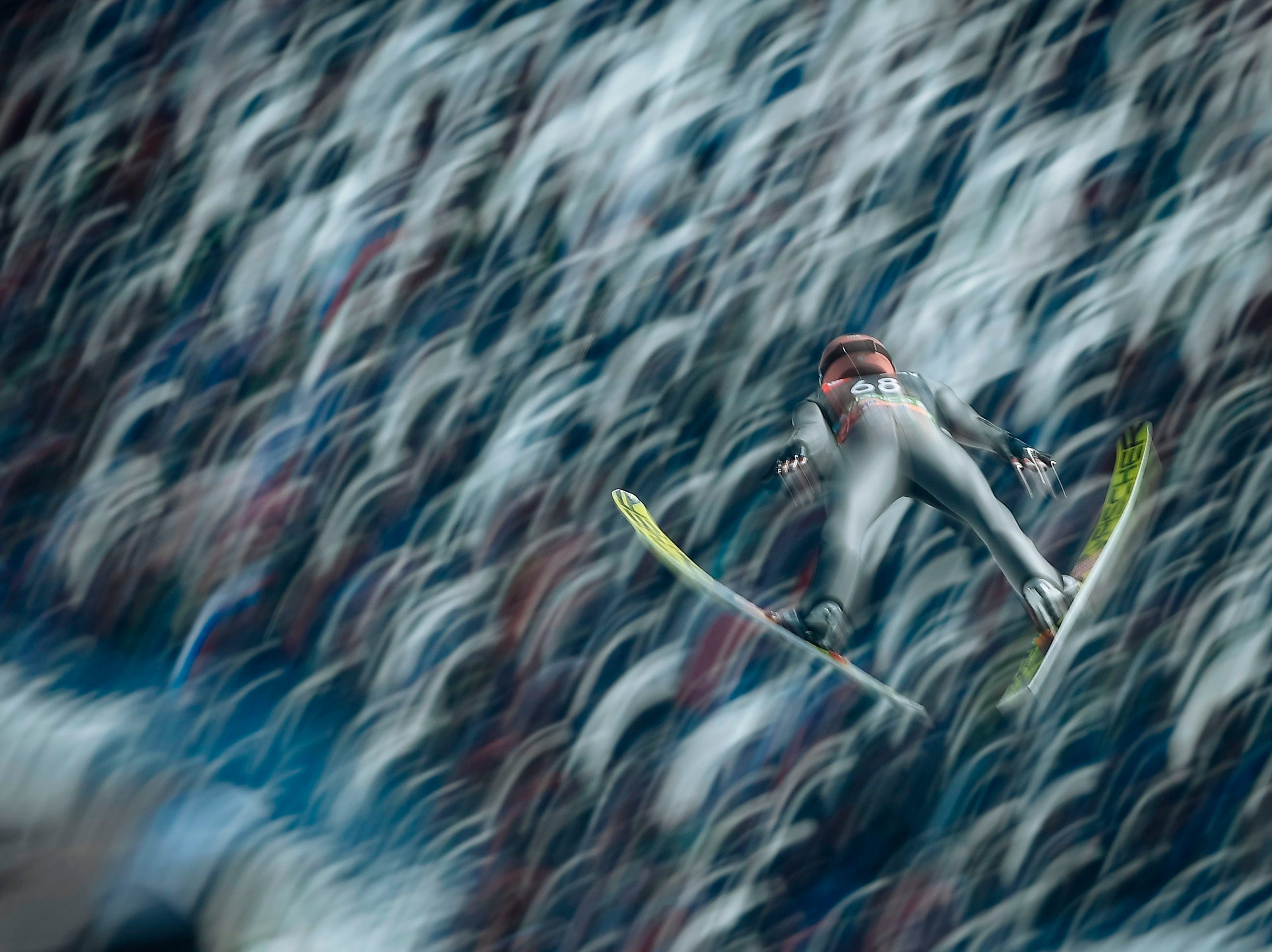 Stefan Kraft of Austria competes during the qualifying round of the FIS Ski Jumping World Cup Men's Flying Hill Individual competition in Planica, Slovenia, on March 21, 2019.