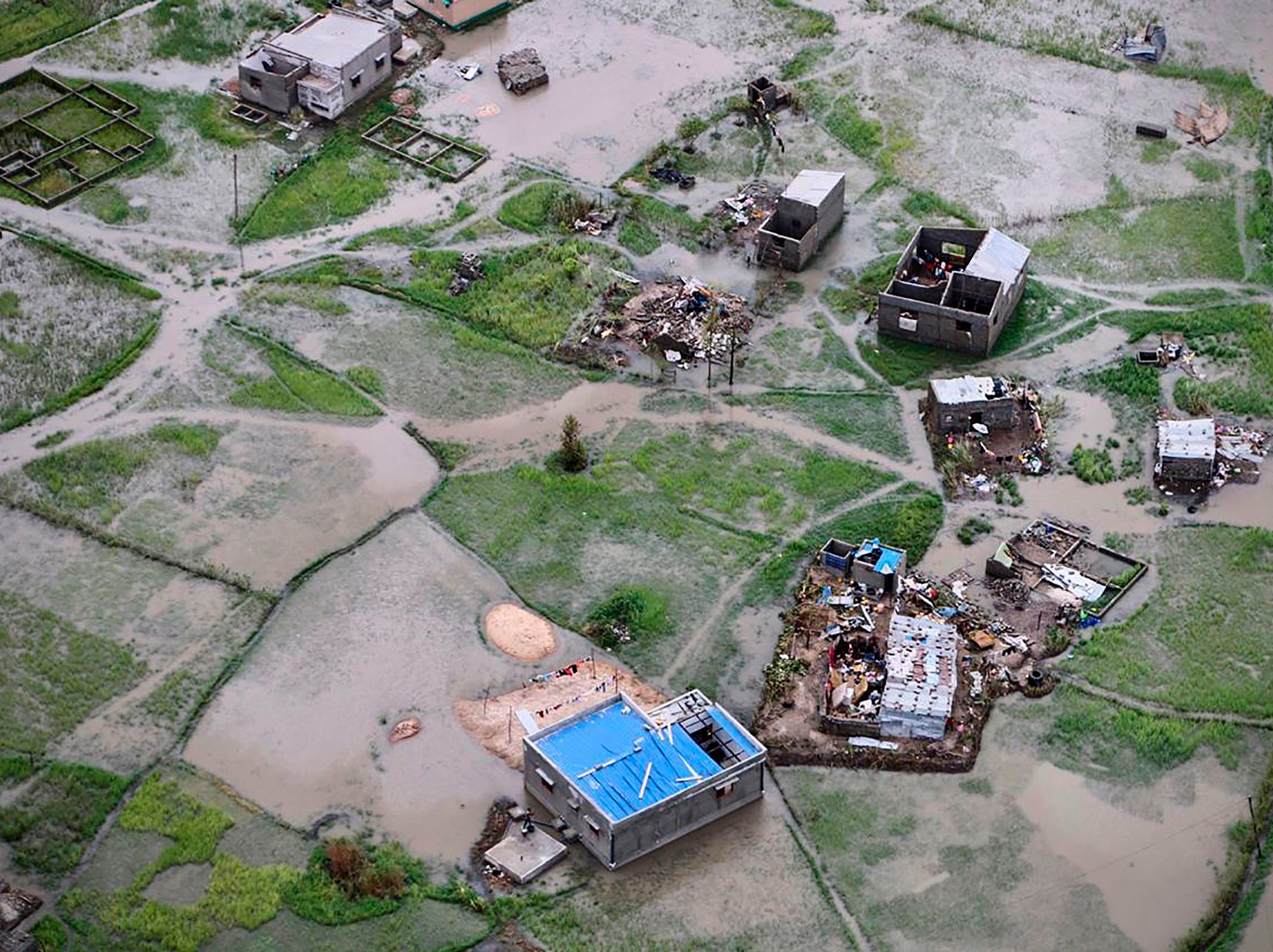 An aerial view a flooded district on the outskirts of the city of Beira, central Mozambique, on March 20, 2019, after Cyclone Idai cut a swathe through Mozambique, Zimbabwe and Malawi. The confirmed death toll stands at more than 300 according to officials. International aid agencies are racing to rescue survivors and meet humanitarian needs in the three countries battered by one of the worst storms to hit southern Africa in decades.