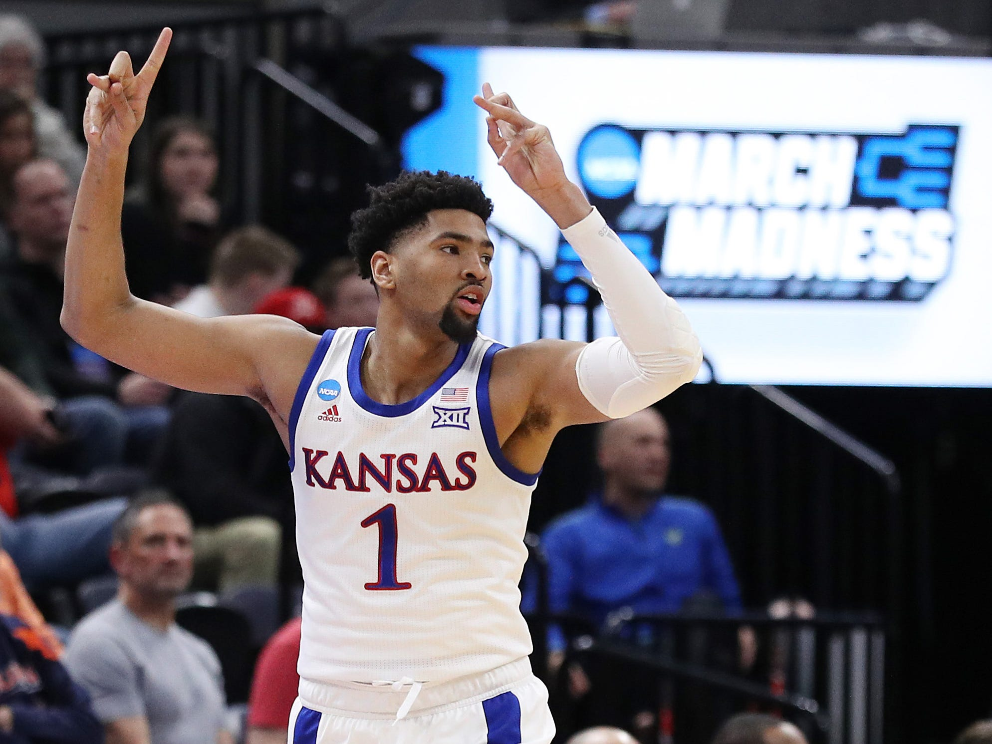 First round: Kansas' Dedric Lawson celebrates during the Jayhawks' rout of Northeastern.