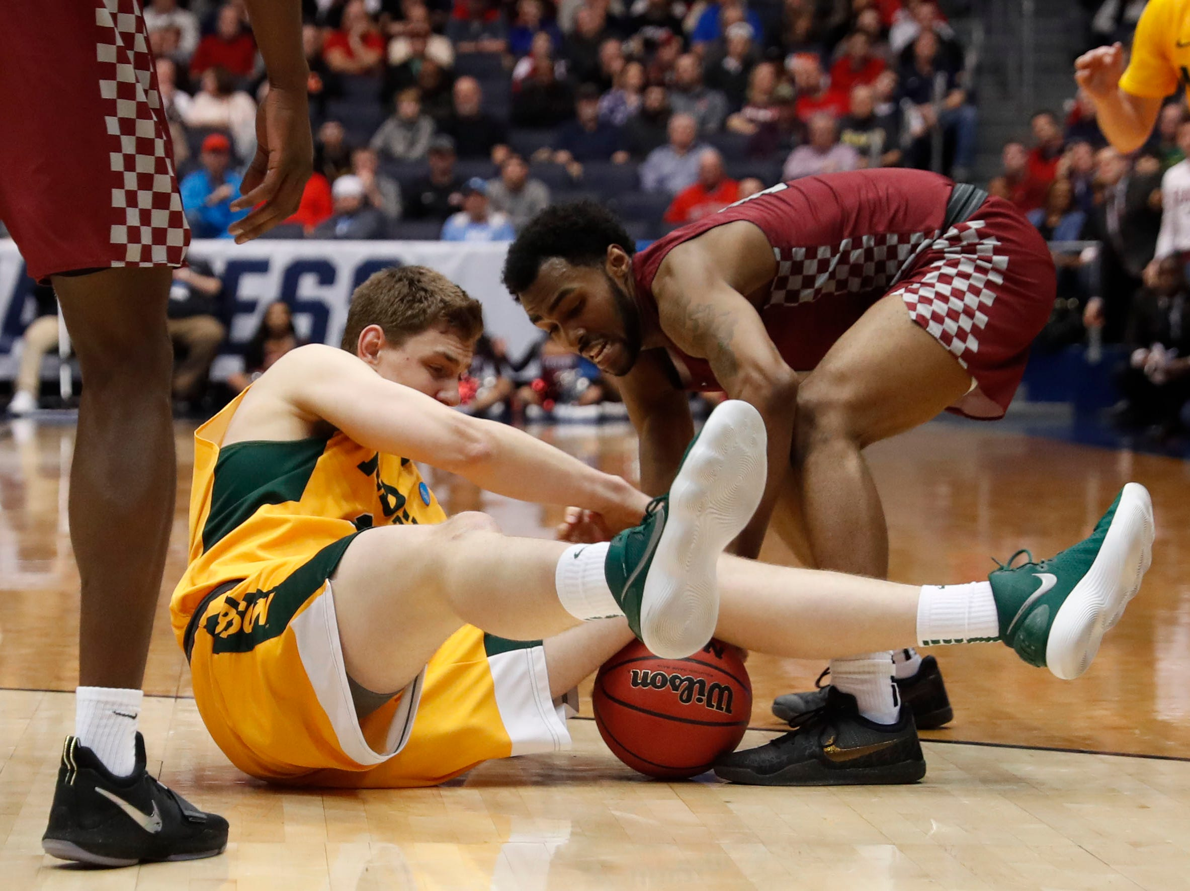 North Dakota State Bison forward Rocky Kreuser (34) and North Carolina Central Eagles guard Randy Miller Jr. (11) battle for the ball in the second half.