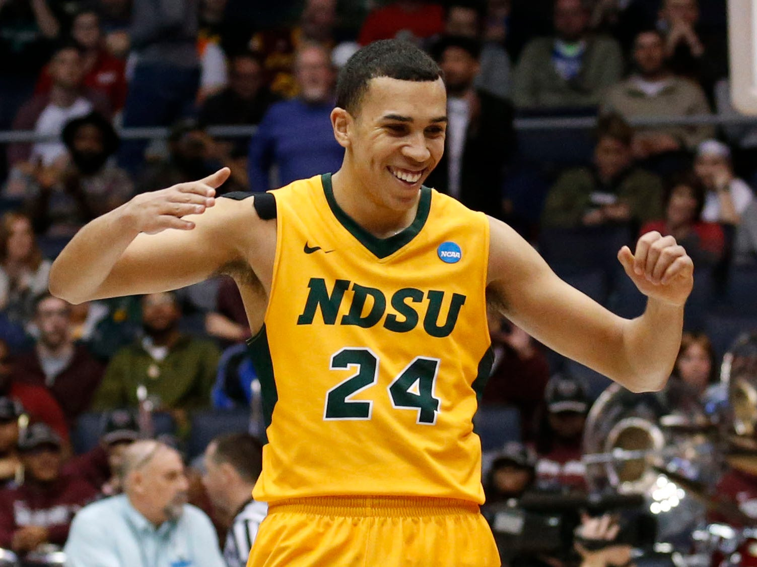 North Dakota State Bison guard Tyson Ward (24) celebrates defeating the North Carolina Central Eagles.