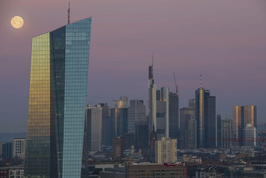 FRANKFURT AM MAIN, GERMANY - MARCH 21: Office buildings, including the corporate headquarters of the European Central Bank (ECB), Commerzbank and Deutsche Bank stand in the financial district in the city center lit by the full moon and the sunrise on March 21, 2019 in Frankfurt, Germany. Some finance-related companies have been moving offices from London to Frankfurt due to uncertainties over Brexit. (Photo by Thomas Lohnes/Getty Images) ORG XMIT: 775312841 ORIG FILE ID: 1137298442