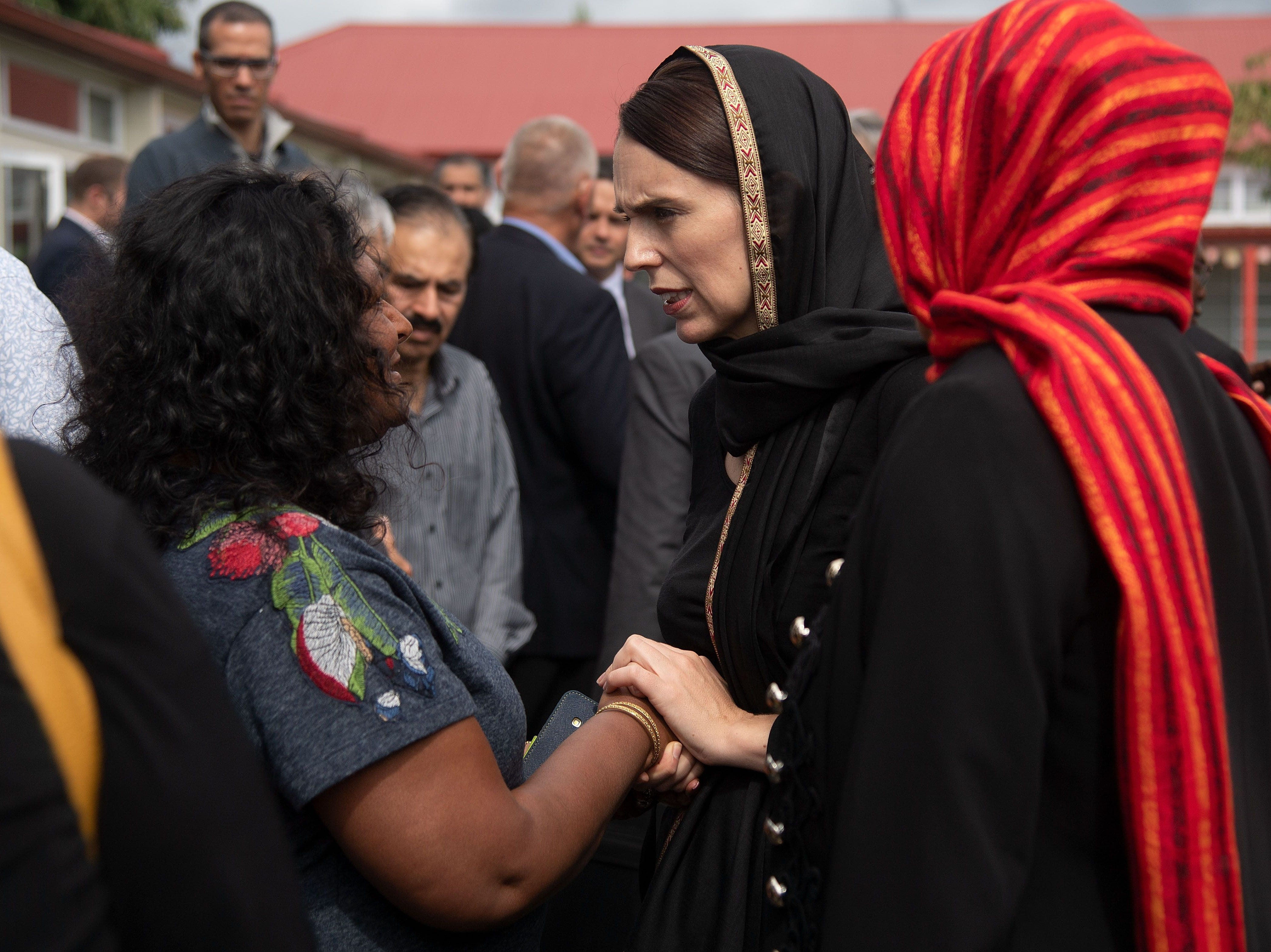 New Zealand Prime Minister Jacinda Ardern speaks with a representative of the refugee centre during a visit to the Canterbury Refugee Centre in Christchurch on March 16, 2019.