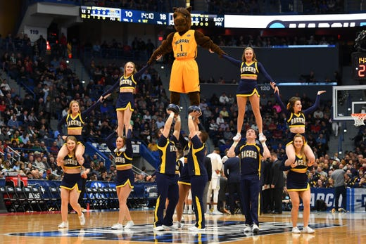 First round: The Murray State Racers cheerleaders perform during the game against the Marquette Golden Eagles.