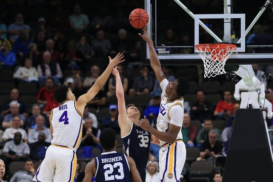 LSU Tigers forward Kavell Bigby-Williams (11) blocks a shot by Yale Bulldogs forward Blake Reynolds (32).