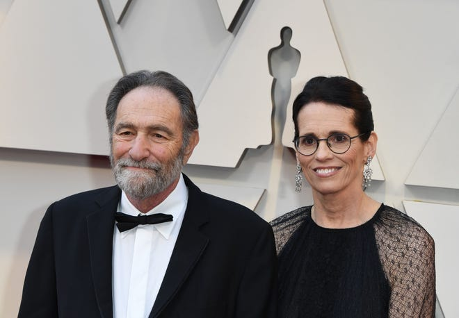 Eric Roth and guest arrive for the Academy Awards in Hollywood, California on Feb. 24, 2019.